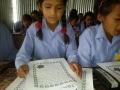 Raithane student reads a message 1