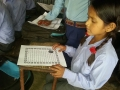 Raithane student with a letter 1