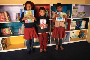 Taltuleshwori School star readers with their prizes posing for a group photo.