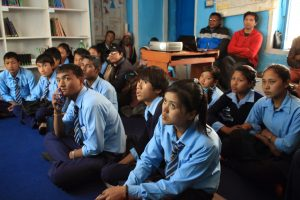 Students and community members listening to a presentation on Fish farming.